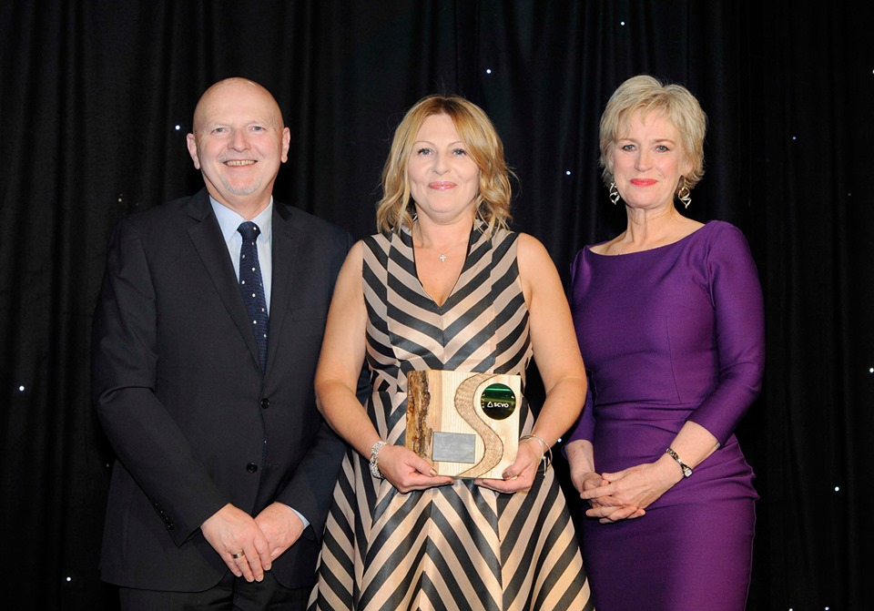Louise Russell being presented with award by Alan Sherry and Sally Magnusson