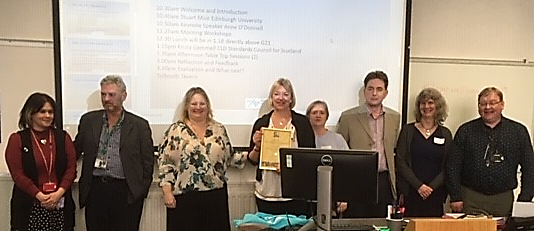 Committee of South East & Central CLD Professional Learning Consortium and Diann Govenlock, Chair, accepting Standards Mark Award