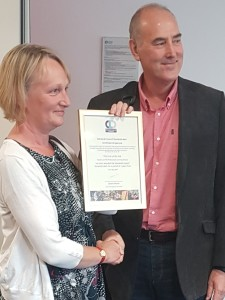 Sue Holland Smith receives certificate from Ashley Pringle